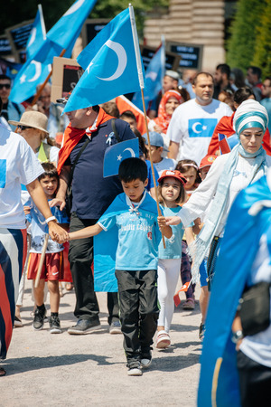 repression: STRASBOURG, FRANCE - JULY 11, 2015: Uyghur human rights activists participate in a demonstration to protest against Chinese governments policy in Uyghur