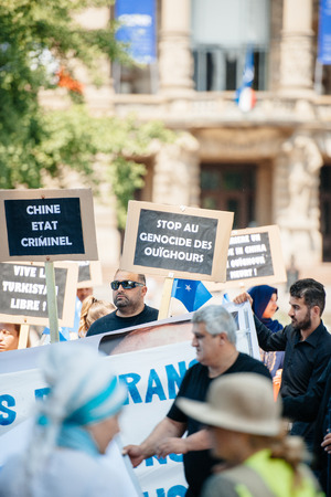 exile: STRASBOURG, FRANCE - JULY 11, 2015: Stop Uyghur genocide -  Uyghur human rights activists participate in a demonstration to protest against Chinese governments policy in Uyghur Editorial