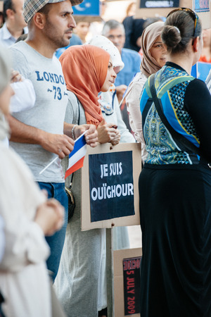 repression: STRASBOURG, FRANCE - JULY 11, 2015:Je suis Ouighour -  Uyghur human rights activists participate in a demonstration to protest against Chinese governments policy in Uyghur Editorial