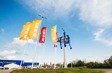ikea: BUCHAREST, ROMANIA - APRIL 30, 2011: IKEA Store flags near its entrance. IKEA is the worlds largest furniture retailer and sells ready to assemble furniture founded in Sweden in 1943. It is also the largest Romanian furniture store Editorial