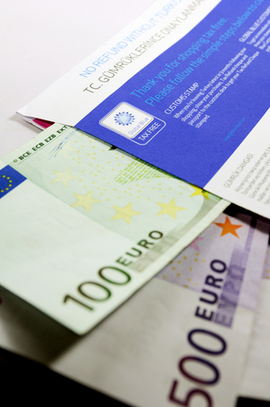 thousands: ISTANBUL, TURKEY - FEBRUARY 06, 2011: Tax Free envelope with thousands of euro in it after claiming back tax. Global Blue is a tourism shopping tax refund company headquartered in Nyon, Switzerland