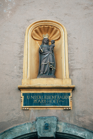 architectural tradition: Statue of Maria holding Jesus at Liebfrauenkirche (German for Church of Our Lady) - the earliest Gothic church in Germany and falls into the architectural tradition of the French Gothic cathedrals.