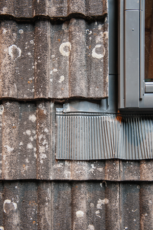 rockwool: Water thermal insulation of a roof tile demonstration next ot a roof window