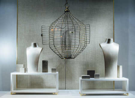 jewlery: Empty jewelry store show-window with a two dummy torso, an empty cage and no gems or gold Stock Photo