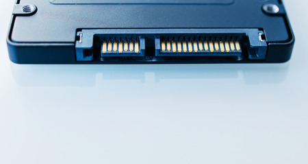 SSD disk drive SATA 6 connection  in blue technological background - tilt-shift lens used to accent the center of the hdd and to emphasize the attention its connections