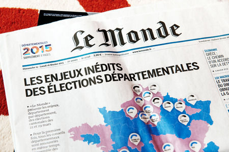 periodicals: PARIS, FRANCE - FEBRUARY 19, 2015: Le Monde magazine with elections in France map on cover.Published from 1944 it is one of the most important and widely respected newspapers in the world