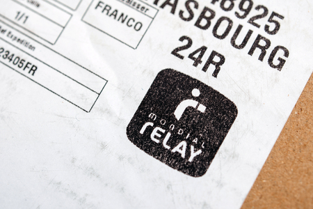 mondial: PARIS, FRANCE - SEPTEMBER 20, 2015: Mondial Relay sticker on parcel cardbox. Modial Relay is a parcel delivery company headquartered in France with operations also in Belgium