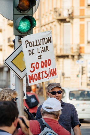 air pollution: STRASBOURG, FRANCE - AUG 6, 2015: People protesting against air pollution in Strasbourg, Alsace, France - man holding placard Air pollution kills 50000 people per year