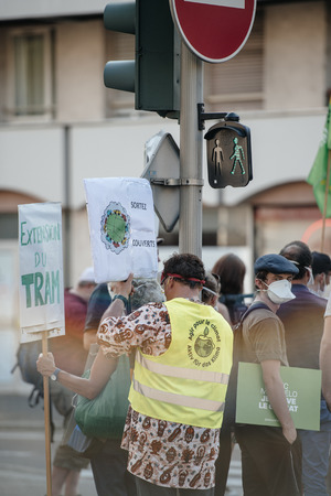 protesting: STRASBOURG, FRANCE - AUG 6, 2015: People wearing air masks protesting against air pollution in Strasbourg, Alsace, France