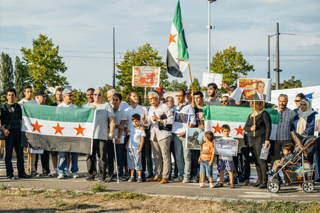 european parliament: STRASBOURG, FRANCE - AUG 20, 2015: People protesting in front of European Parliament denouncing the Syrian airstrikes on a Damascus suburb of Douma which killed more than 80 people Editorial