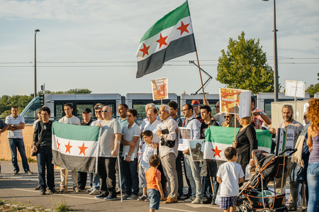 political and social issues: STRASBOURG, FRANCE - AUG 20, 2015: People protesting in front of European Parliament denouncing the Syrian airstrikes on a Damascus suburb of Douma which killed more than 80 people Editorial