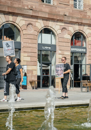 outcry: STRASBOURG, FRANCE - AUG 22, 2015: Marine conservation non-profit organization Sea Shepherd protesting against the slaughter of pilot whales and arrest of 7 crew members - solidarity marching, holding placards