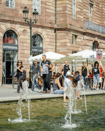 dissent: STRASBOURG, FRANCE - AUG 22, 2015: Marine conservation non-profit organization Sea Shepherd protesting against the slaughter of pilot whales and arrest of 7 crew members - solidarity marching