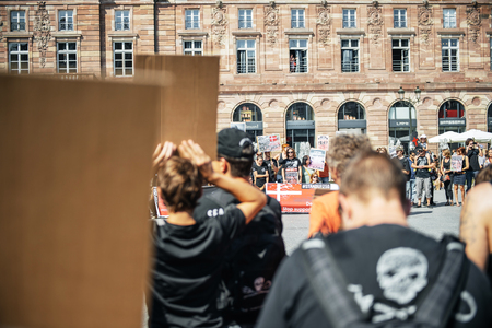 nonprofit: STRASBOURG, FRANCE - AUG 22, 2015: Marine conservation non-profit organization Sea Shepherd protesting against the slaughter of pilot whales and arrest of 7 crew members - people protesting Editorial