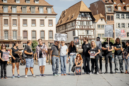 outcry: STRASBOURG, FRANCE - AUG 22, 2015: Marine conservation non-profit organization Sea Shepherd protesting against the slaughter of pilot whales and arrest of 7 crew members -