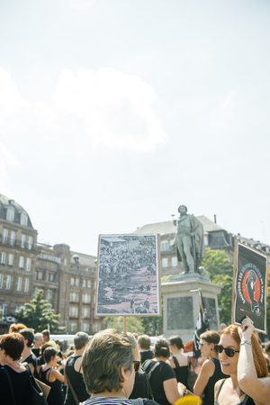 outcry: STRASBOURG, FRANCE - AUG 22, 2015: Marine conservation non-profit organization Sea Shepherd protesting against the slaughter of pilot whales and arrest of 7 crew members - group with placards Editorial