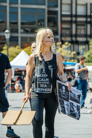 outcry: STRASBOURG, FRANCE - AUG 22, 2015: Marine conservation non-profit organization Sea Shepherd protesting against the slaughter of pilot whales and arrest of 7 crew members - woman with placard Keep Calm Editorial