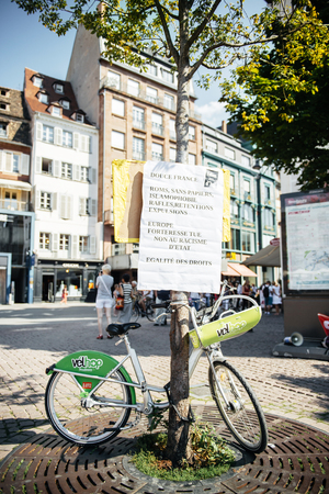 outcry: People protesting against immigration policy and border management which asks for commitment in the wake of migrants boat disasters - placard abut freedom rights aboove bike