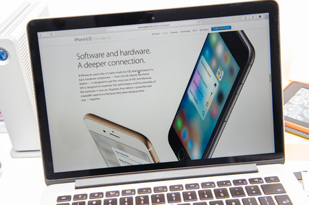 announced: PARIS, FRANCE - SEP 9, 2015: Apple Computers website on MacBook Pro Retina in a creative room environment showcasing the newly announced iPhone 6s software and hardware connection