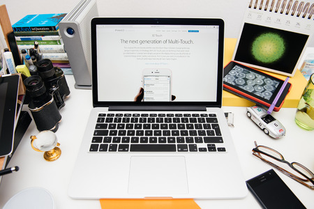 apple computers: PARIS, FRANCE - SEP 9, 2015: Apple Computers website on MacBook Pro Retina in a creative room environment showcasing the newly announced next generation multi-touch called 3D Touch Editorial