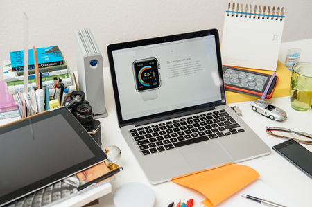 announced: PARIS, FRANCE - SEP 10, 2015: Apple Computers website on MacBook Pro Retina in a creative room environment showcasing the newly announced Apple WatchOS 2