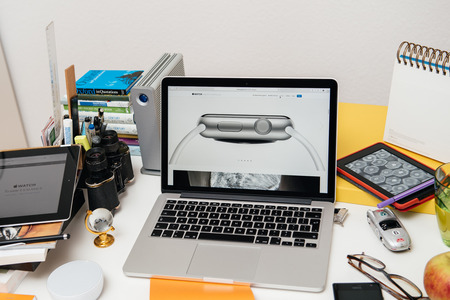 apple computers: PARIS, FRANCE - SEP 10, 2015: Apple Computers website on MacBook Pro Retina in a creative room environment showcasing the newly announced 7000 Series Aluminum on Apple Watch