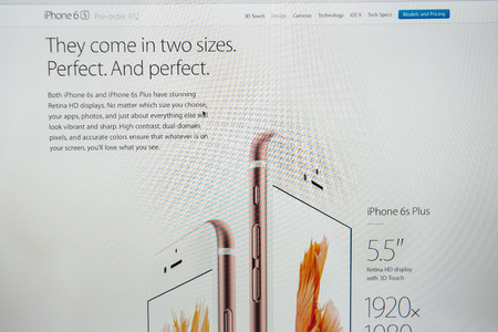 announced: PARIS, FRANCE - SEP 9, 2015: Apple Computers website on MacBook Pro Retina in a creative room environment showcasing the newly announced iPhone 6S and 6S Plus perfect sizes