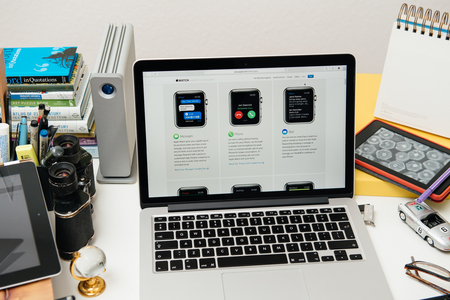 announced: PARIS, FRANCE - SEP 10, 2015: Apple Computers website on MacBook Pro Retina in a creative room environment showcasing the newly announced Apple Watch Apps Editorial