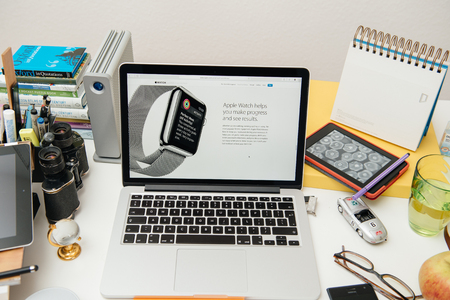 announced: PARIS, FRANCE - SEP 10, 2015: Apple Computers website on MacBook Pro Retina in a creative room environment showcasing the newly announced WatchOS 2 Editorial