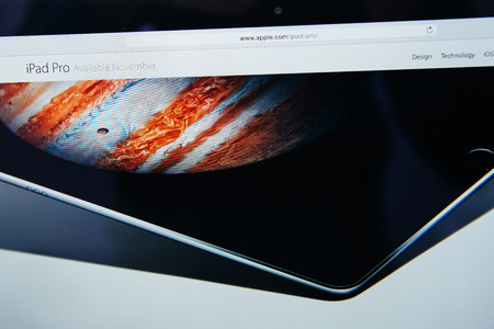 announced: PARIS, FRANCE - SEP 9, 2015: Apple Computers website on MacBook Pro Retina in a creative room environment showcasing the newly announced iPad Pro availability date in November