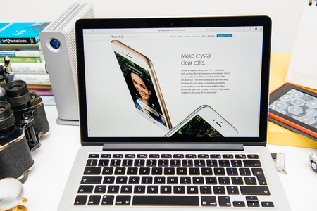 announced: PARIS, FRANCE - SEP 9, 2015: Apple Computers website on MacBook Pro Retina in a creative room environment showcasing the newly announced iPhone 6S with Crystal Clear calls