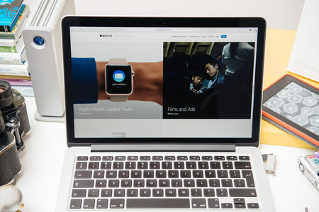 retina: PARIS, FRANCE - SEP 10, 2015: Apple Computers website on MacBook Pro Retina in a creative room environment showcasing the newly announced Apple Watch update Editorial