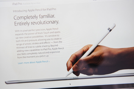 unveiling: PARIS, FRANCE - SEP 9, 2015: Apple Computers website on MacBook Pro Retina in a creative room environment showcasing the newly announced