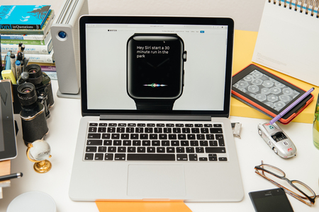 apple computers: PARIS, FRANCE - SEP 10, 2015: Apple Computers website on MacBook Pro Retina in a creative room environment showcasing the newly announced new Apple Watch OS