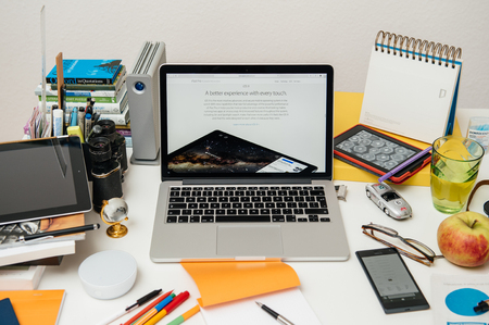 pro: PARIS, FRANCE - SEP 9, 2015: Apple Computers website on MacBook Pro Retina in a creative room environment showcasing the newly announced iPAd pro and iOS 9 Editorial