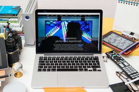 apple computers: PARIS, FRANCE - SEP 10, 2015: Apple Computers website on MacBook Pro Retina in a creative room environment showcasing the newly announced The New Apple TV Editorial