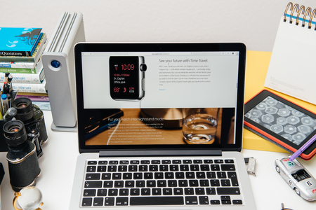 unveiling: PARIS, FRANCE - SEP 10, 2015: Apple Computers website on MacBook Pro Retina in a creative room environment showcasing the newly announced Time Travel on Apple Watch
