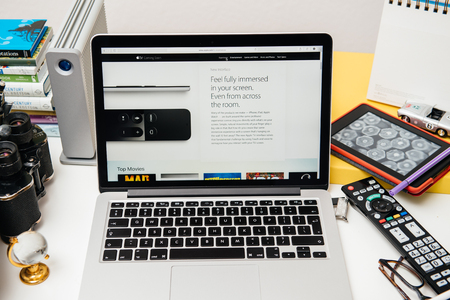 announced: PARIS, FRANCE - SEP 10, 2015: Apple Computers website on MacBook Pro Retina in a creative room environment showcasing the newly announced Apple TV Editorial