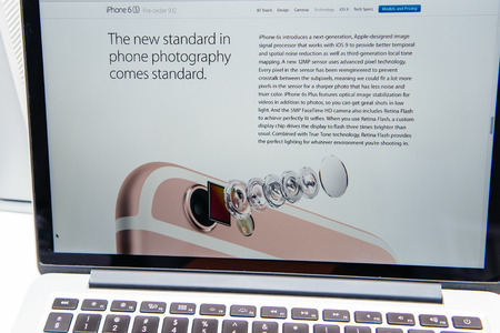 announced: PARIS, FRANCE - SEP 9, 2015: Apple Computers website on MacBook Pro Retina in a creative room environment showcasing the newly announced iPhone 6S camera Editorial