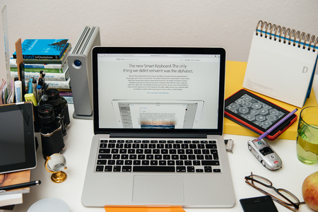 announced: PARIS, FRANCE - SEP 10, 2015: Apple Computers website on MacBook Pro Retina in a creative room environment showcasing the newly announced Smart Keyboard for iPad Pro