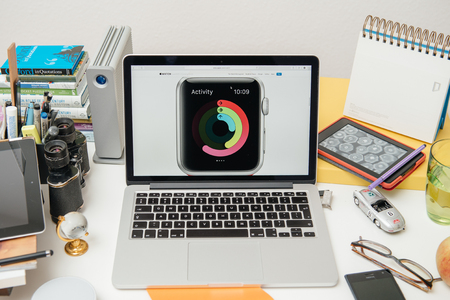 announced: PARIS, FRANCE - SEP 10, 2015: Apple Computers website on MacBook Pro Retina in a creative room environment showcasing the newly announced Activity on Apple Watch
