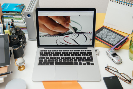 announced: PARIS, FRANCE - SEP 10, 2015: Apple Computers website on MacBook Pro Retina in a creative room environment showcasing the newly announced Apple Pencil for iPad Pro Editorial