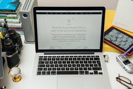 apple computers: PARIS, FRANCE - SEP 10, 2015: Apple Computers website on MacBook Pro Retina in a creative room environment showcasing the newly announced WatchOS 2 Editorial