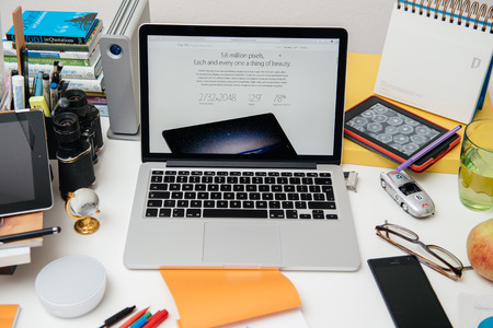 announced: PARIS, FRANCE - SEP 10, 2015: Apple Computers website on MacBook Pro Retina in a creative room environment showcasing the newly announced iPad pro with its 5.6 million pixels display