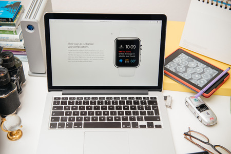 apple computers: PARIS, FRANCE - SEP 10, 2015: Apple Computers website on MacBook Pro Retina in a creative room environment showcasing the newly announced Apple WatchOS 2