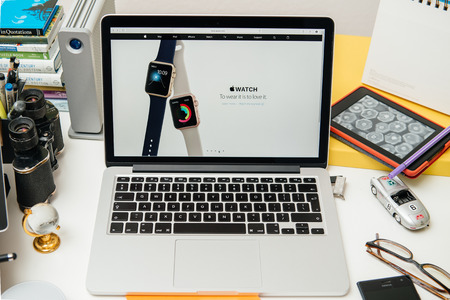 unveiling: PARIS, FRANCE - SEP 10, 2015: Apple Computers website on MacBook Pro Retina in a creative room environment showcasing the newly announced Apple Watch update Editorial