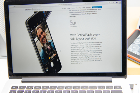 announced: PARIS, FRANCE - SEP 9, 2015: Apple Computers website on MacBook Pro Retina in a creative room environment showcasing the newly announced iPhone 6S selfie camera