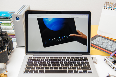 apple computers: PARIS, FRANCE - SEP 9, 2015: Apple Computers website on MacBook Pro Retina in a creative room environment showcasing the newly announced iPad Pro