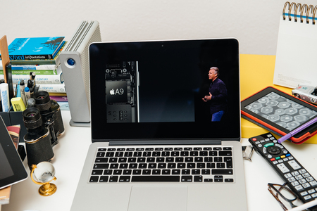 apple computers: PARIS, FRANCE - SEP 10, 2015: Apple Computers website on MacBook Pro Retina in a creative room environment showcasing the newly announced A9 chip in Apple iphone 6s