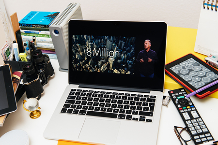 announced: PARIS, FRANCE - SEP 10, 2015: Apple Computers website on MacBook Pro Retina in a creative room environment showcasing the newly announced iPhone 6S